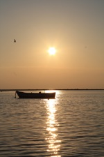 Boat at sunset in Porto Cesareo